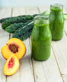 Kale and apricot smoothie Stock Photos