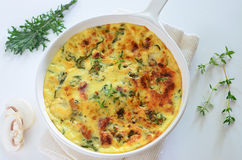 Kale and bacon frittata Stock Image