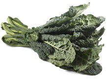 Kale. A bunch of Tuscan kale isolated on a white background royalty free stock photography