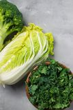 Kale, chinese cabbage, broccoli on a gray background. Top view, copy space for text, selective focus royalty free stock photos