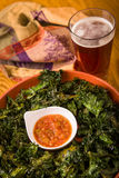 Kale Chips and Beer Royalty Free Stock Photography