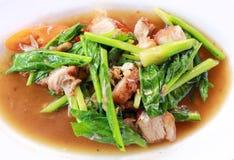 Kale with crispy pork Royalty Free Stock Photos