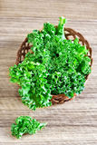 Kale. Fresh green kale leaves in basket. Selective focus Royalty Free Stock Photography