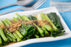 Kale fried in oyster sauce Stock Photos