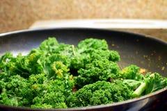 Kale in frying pan Royalty Free Stock Image