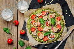 Kale oats pizza crust with tomato, red onion and mushrooms Royalty Free Stock Photo