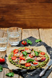 Kale oats pizza crust with tomato, red onion and mushrooms Royalty Free Stock Image