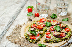 Kale oats pizza crust with tomato, red onion and mushrooms Stock Images