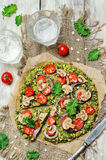 Kale oats pizza crust with tomato, red onion and mushrooms Stock Photos