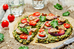 Kale oats pizza crust with tomato, red onion and mushrooms Royalty Free Stock Photos