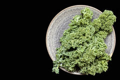 Kale on Plate over Black Overhead View Stock Photo
