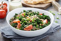 Kale and quinoa salad with tomatoes. Vegan kale and quinoa salad with tomatoes Stock Photo