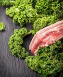 Kale and Raw Pork brisket on slate Royalty Free Stock Photos