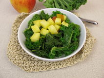 Kale salad with baked apple. Homemade kale salad with baked apple stock image