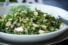 Kale Salad. Kale and quinoa salad with dill vinaigrette and almonds royalty free stock photo