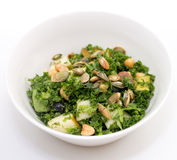 Kale salad in white bowl on white Royalty Free Stock Images