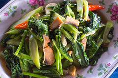 Kale with Salty Fish. Fried kale with salty fish, a common menu in Thailand Stock Images