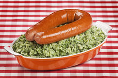 Kale with smoked sausage or 'Boerenkool met worst' Stock Image