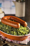 Kale with smoked sausage or 'Boerenkool met worst' Royalty Free Stock Image