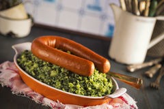 Kale with smoked sausage or 'Boerenkool met worst' Stock Photography