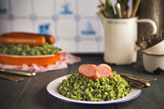 Kale with smoked sausage or Boerenkool met worst Royalty Free Stock Image