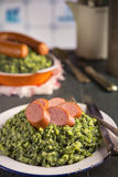 Kale with smoked sausage or 'Boerenkool met worst' Royalty Free Stock Photos