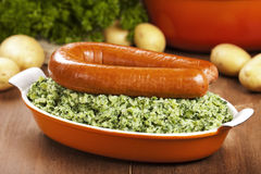 Kale with smoked sausage or 'Boerenkool met worst' Royalty Free Stock Photography