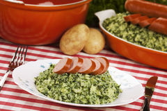 Kale with smoked sausage or Boerenkool met worst Stock Image
