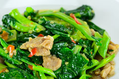 Kale vegetable fried with oil with pork Royalty Free Stock Photo