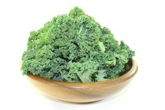 Kale in a wood bowl Royalty Free Stock Images
