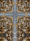 Kaleidoscope cross: pile of logs royalty free stock photography
