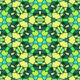 Kaleidoscope mosaic seamless pattern texture background in green, blue and yellow colors Royalty Free Stock Image