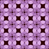 KaleidoscopePattern3. Purple repeat abstract flowers on the dark-red background. Vector illustration Royalty Free Stock Image