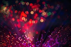 Kaleidoskopische, bunte mehrfarbige Faseroptiklichter auf einer Querstation stockfotos