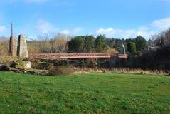 Kalemouth suspension bridge. Kalemouth bridge over river Teviot Stock Photography