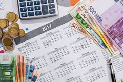 Kalendarz, pióro euro rachunki i kalkulator umieszczający, Obrazy Royalty Free