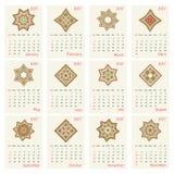 2017 kalendarz z etnicznym round ornamentu wzorem w czerwonych i zielonych kolorach ilustracja wektor
