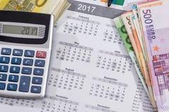 kalendarz z euro rachunkami z kalkulatora piórem Fotografia Royalty Free