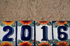 Kalenderåret numrerar 2016 på keramiska tegelplattor Fotografering för Bildbyråer