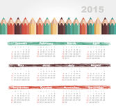 Kalender 2015 år med kulöra blyertspennor Arkivbilder