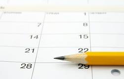 Kalender en een potlood Stock Afbeeldingen