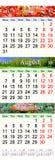 Kalender för Juli August September 2017 med tre färgade bilder Arkivfoton