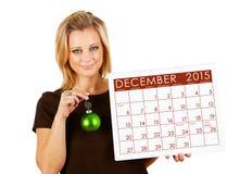 2015 Kalender: Kerstmisornament van holdingsdecember Stock Afbeeldingen
