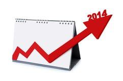 Kalender med pilar som ökar tillväxt i 2014 Arkivbilder