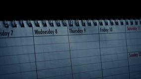 Kalender med regnskuggor över den lager videofilmer