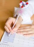 Kalender met pen Stock Foto's