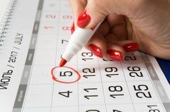Kalender mit einem engagierten Datum am 5. Juli Lizenzfreie Stockfotografie