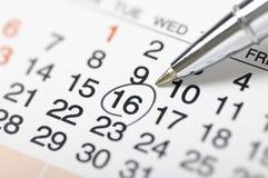Kalender-plaatsende een datum Stock Afbeelding