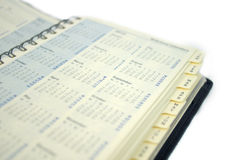 Kalender/Planer mit Abschluss oben auf Monat Lizenzfreie Stockbilder
