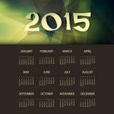 Kalender-Schablone 2015 mit grünem und gelbem dreieckigem geometrischem Hintergrund Stockbild